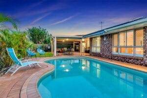 image of pool at sunset, taken by Elanora Realty for marketing purposes